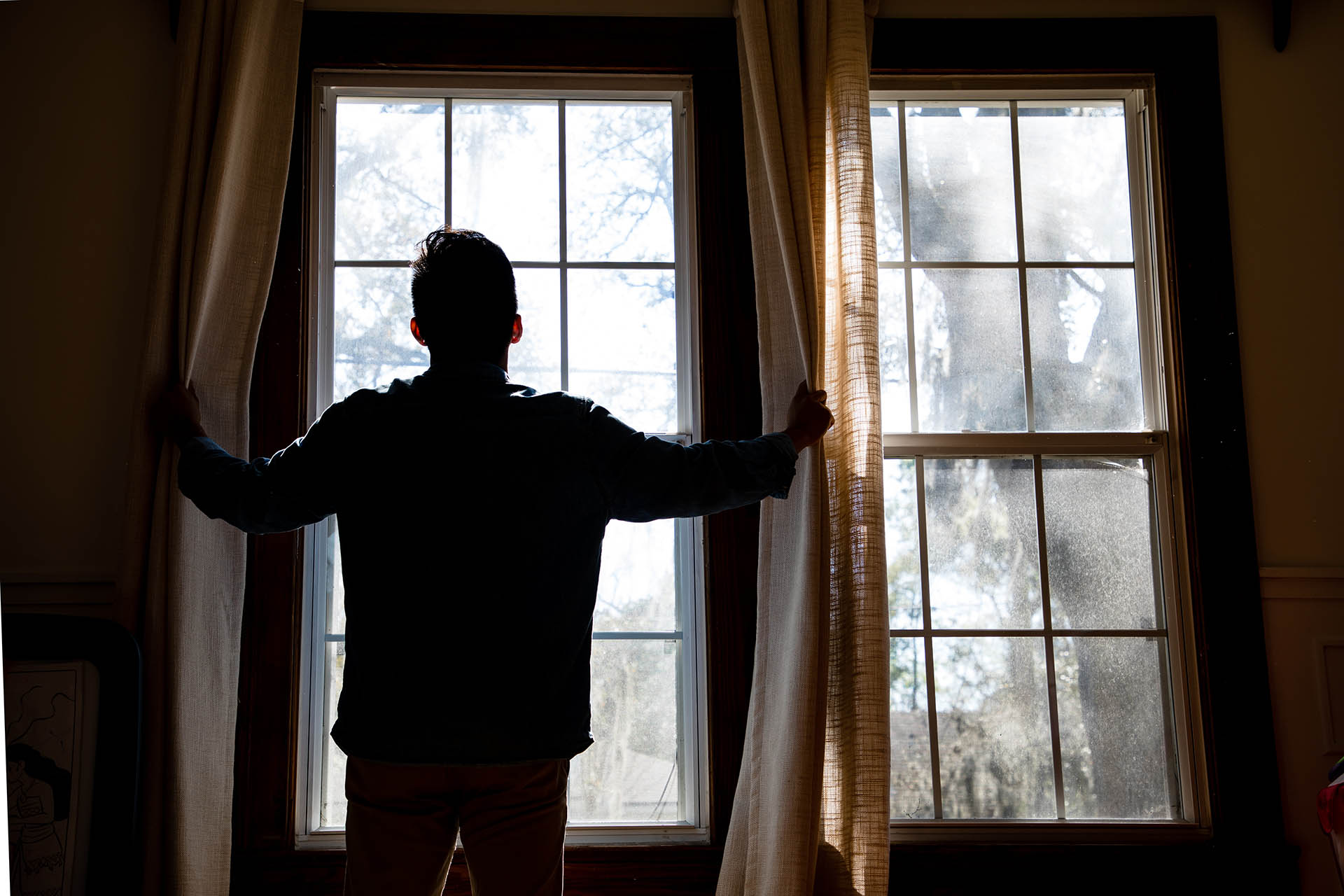 A man in front of a window