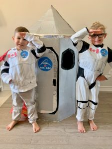 Two children in spaceship outfits